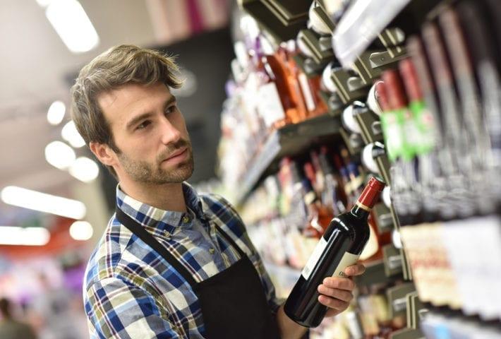 shop fittings for liquor store man choosing